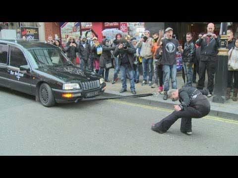 Youtube Spotlight: Woman pulls 2.5 tonne hearse with her hair (Video)
