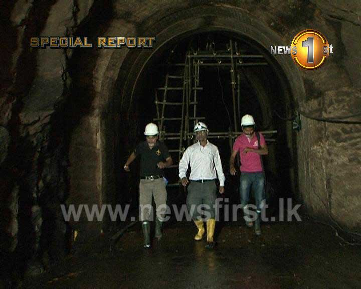 Newsfirst crew walks along Laxapana Reservoir tunnel in a thirst to know more