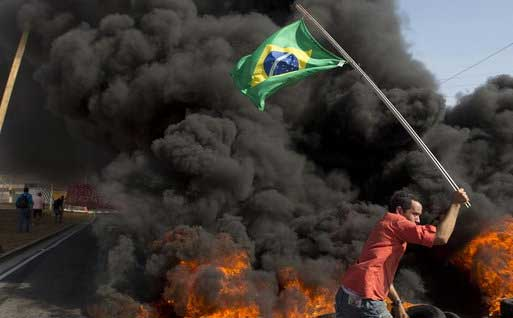 Brazil police, protesters clash as World Cup begins