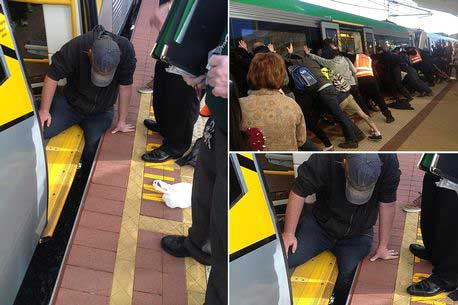 Commuters push train off man whose leg became trapped between carriage and platform