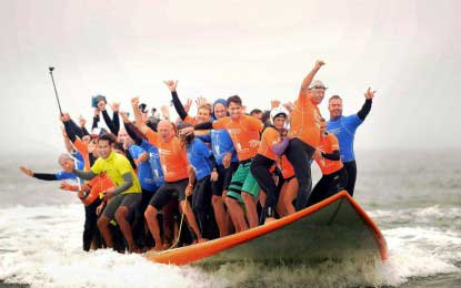 "Sixty six surfers set record for most ""people riding a board at once"""