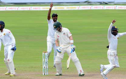 Sri Lanka bowls Australia in to anxious 2nd day conclusion