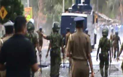 Police fire tear gas at protesters in Dambulla