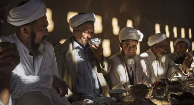 China Uighurs: Xinjiang ban on long beards and veils