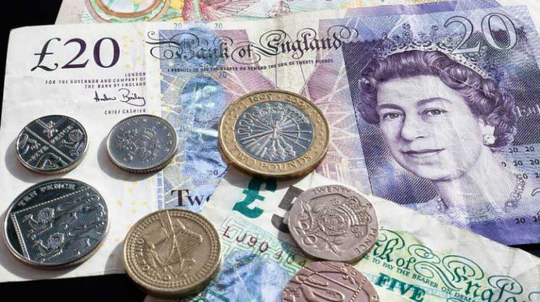 British pound steadies as Theresa May prepares minority government