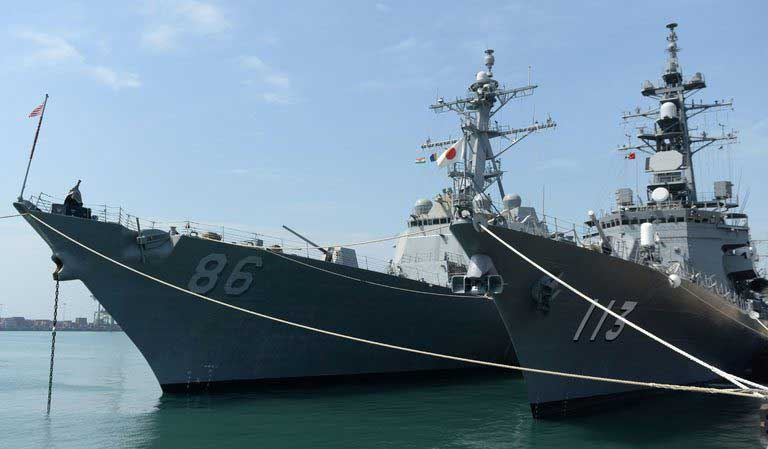 US, India and Japan begin naval exercises, as China looks on