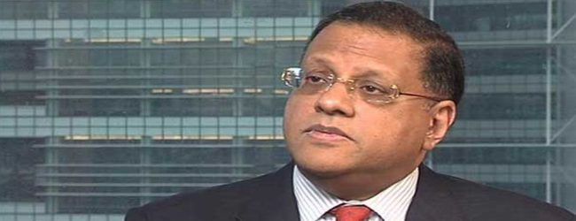 Fugitive Arjuna Mahendran located in Singapore