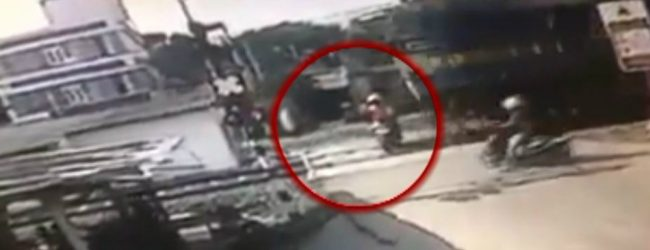CCTV FOOTAGE: Motorbike collides with a train