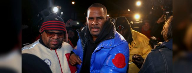 R. Kelly turns himself to authorities following sexual assault charges