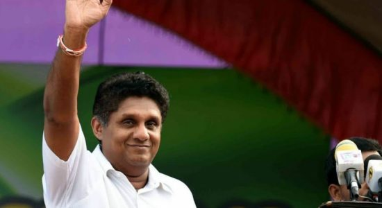 Minister Sajith Premadasa pays homage to the Sacred Tooth Relic