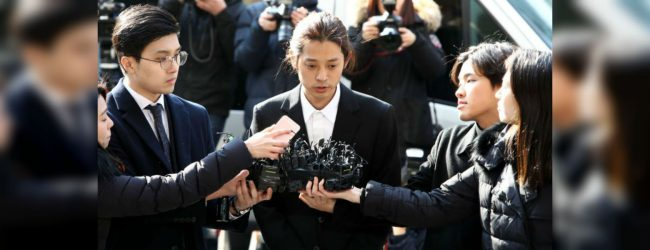 South Korean K-pop singer embroiled in sex scandal arrives at court